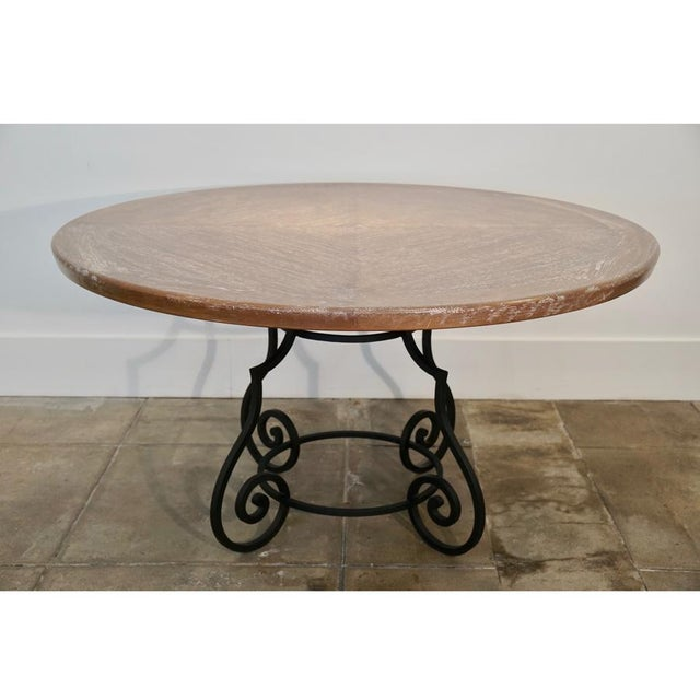 The iron Base was purchased from Paul Ferrante in the late 1950's. The top was repurposed from a 1970's dining table.