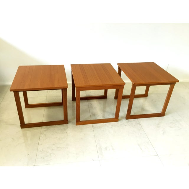 This lovely set of three teak interlocking nesting tables is a classic. The cubed shape plays well in any space, offering...