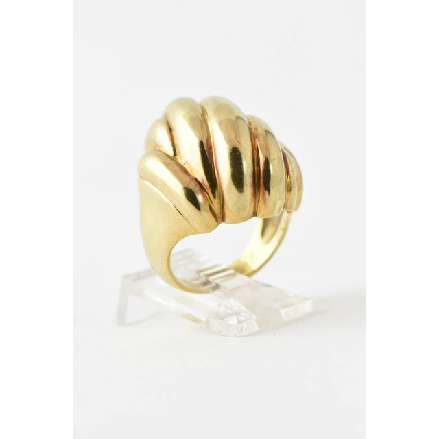 Highly stylized 3 dimensional ribbed design 14k yellow gold ring. This ring was sized so the mark is no longer there. The...