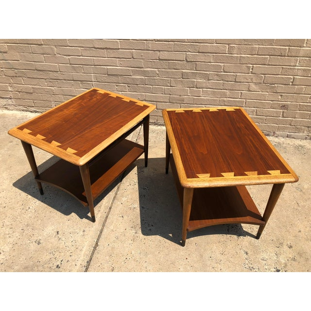A pair of Lane Acclaim end tables with contrasting dovetail construction, lower shelf, and brass capped feet. Absolutely...