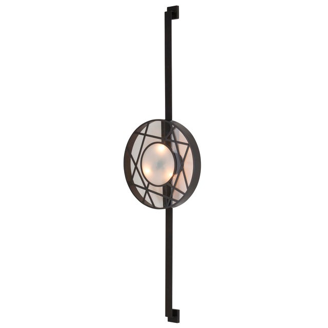 Lighting as art, this six foot tall wall sconce makes a statement! For outdoor use in covered area only.