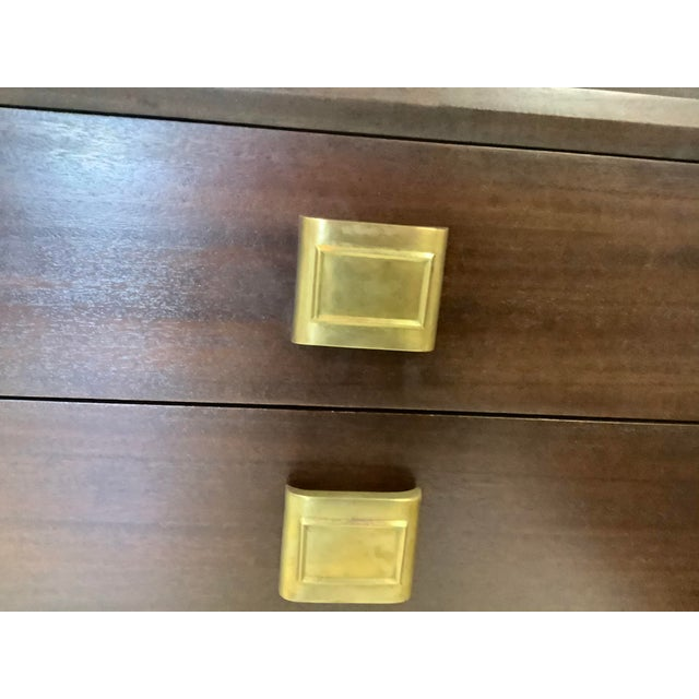 Handsome pair of deco chests, in mahogany & brass, by Futurama. Each has 3 drawers, and is dated 1949. The hardware is...