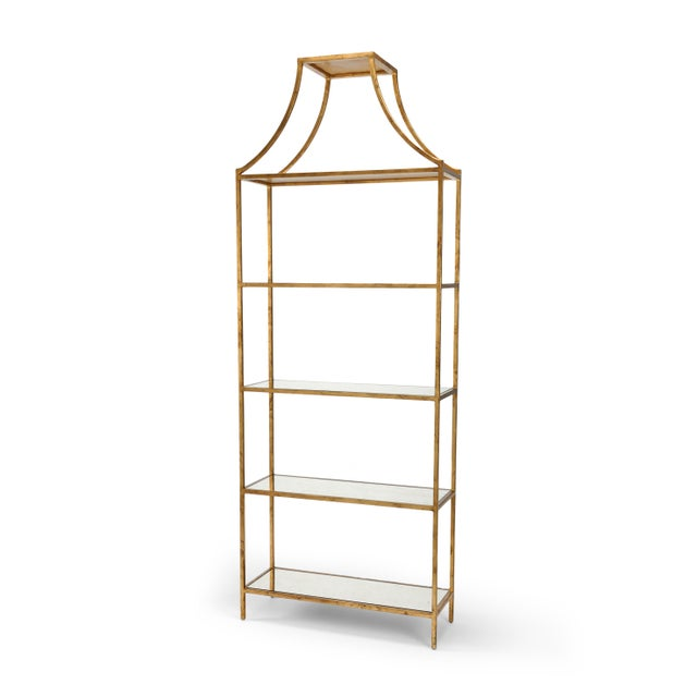 This is a Chelsea House Inc gilt shelf. The piece is made of iron and features an antique gold leaf finish. It's a part of...