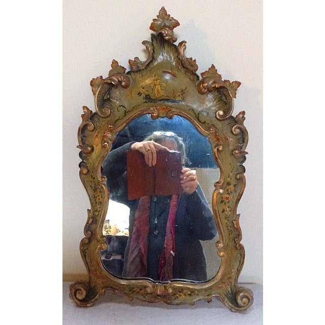 A beautiful little chinoiserie decorated Venetian mirror with original glass.