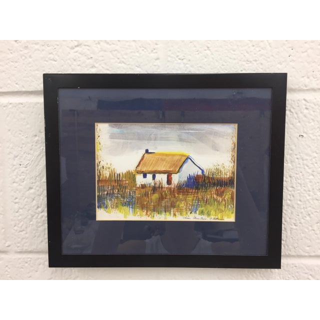 "Framed and matted watercolor of a house in a field. Bottom notes in pencil ""Casa Alem Tejo"". Signed by artist in bottom..."