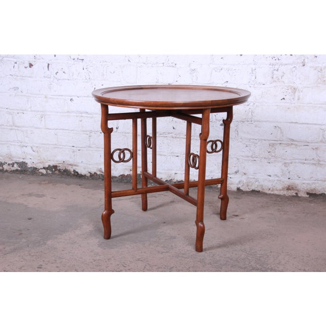 Offering an exceptional walnut and burl wood Chinoiserie occasional table designed by Michael Taylor for his Far East...