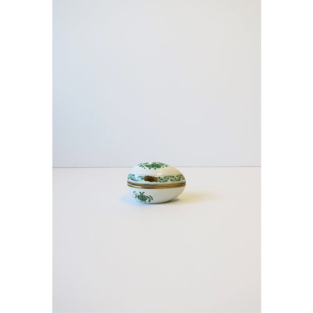 A beautiful white porcelain hand painted egg-shaped box from luxury maker HEREND, Hungary, circa 20th century. This Herend...