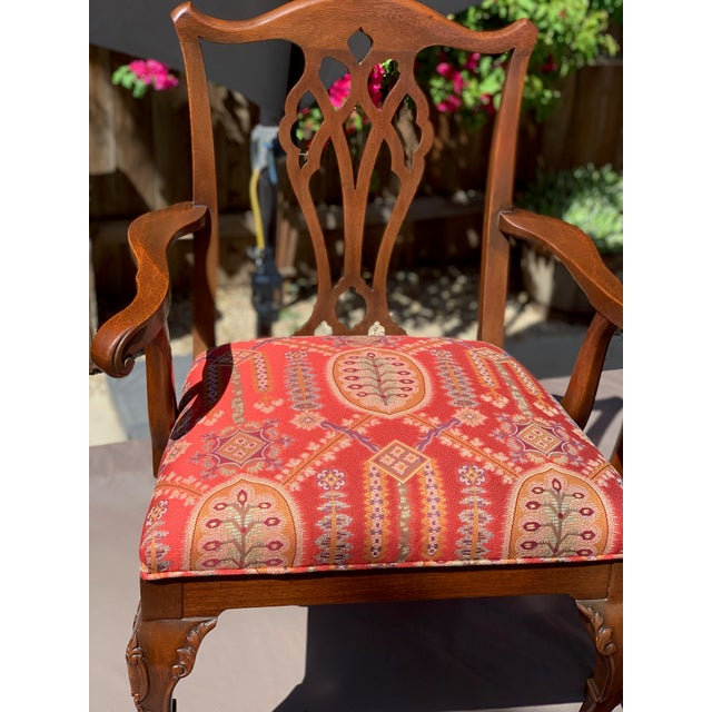Pair of 20th C. mahogany chippendale designer arm chair with silk Lampas fabric. Displays beautifully carved feet with...