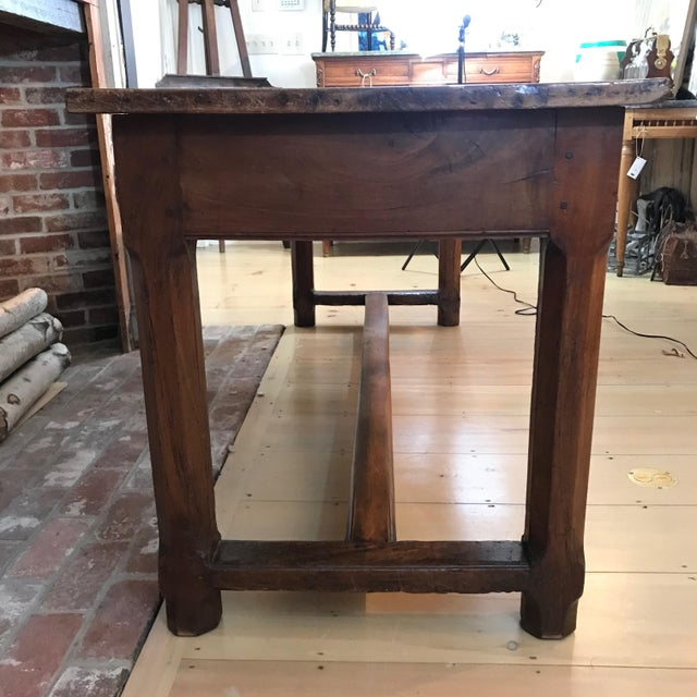 A spectacularly aged walnut farmhouse table from Southern France having a marvelous solid thick top, canted corners and...