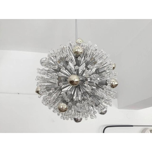 This chandelier, with glass pearls and glass elements, designed by Emil Stejnar for Rupert Nikoll circa 1955. The frame is...