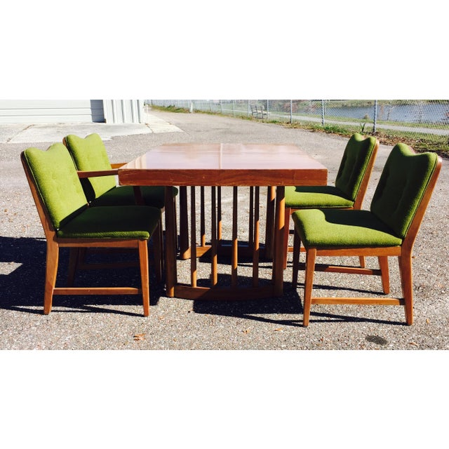 Dining set believed to be attributed to Paul Laszlo. The chairs are in excellent condition. Set includes three side chairs...