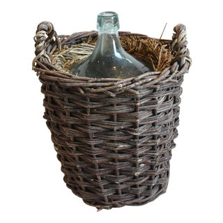 Antique French Demijohn Bottle in Willow Basket With Handles For Sale