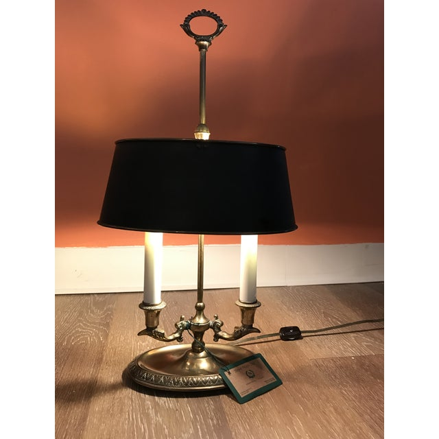 Handsome Brass Bouillotte Lamp. Black metal shade's interior is painted brass. Cord features inline on/off switch. Lamp is...