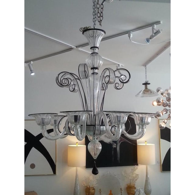 This large scale, stylish and dramatic Murano glass chandelier dates to the 1990s and was acquired from a Palm Beach...