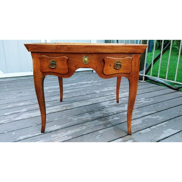 Vintage Baker Furniture Milling Road mid century Walnut end table with one drawer. It has a wood gallery raised rim around...