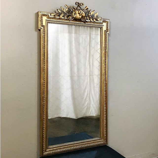This superb 19th century French Louis XVI Style Mirror designed in Paris during Napoleon III Period harkens back to a...