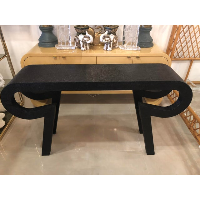 Vintage grasscloth console table lacquered in black.