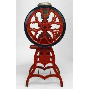 American Victorian red and black painted iron full standing coffee grinder with metal top. Signed: Cha's. Parker Co....