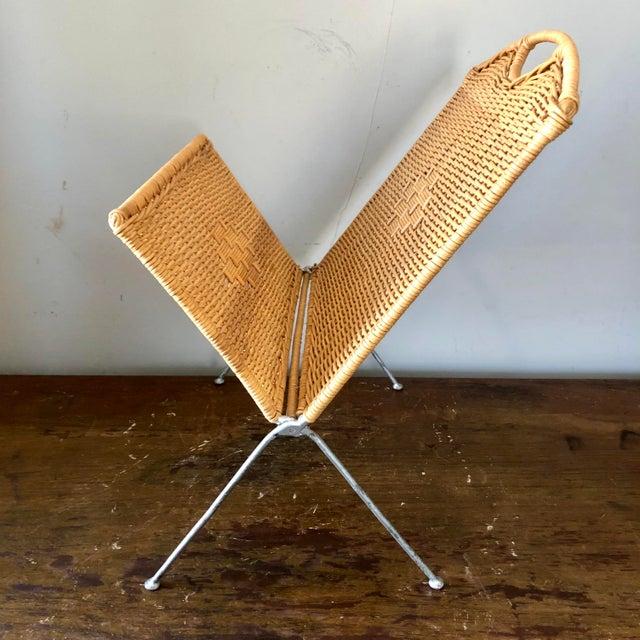 Mid century folding wicker magazine holder.