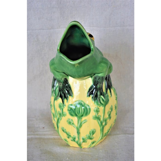 A colorful and quirky frog pitcher by Sur la Table made in Portugal. A Bordallo Pinheiro design. This pitcher would be a...