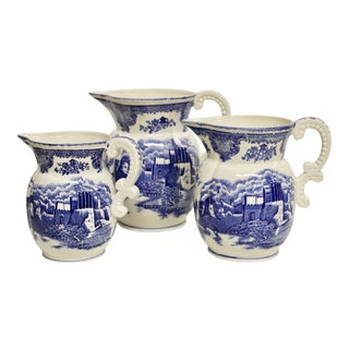Scenic Blue Transferware Graduated Pitchers, S/3 For Sale