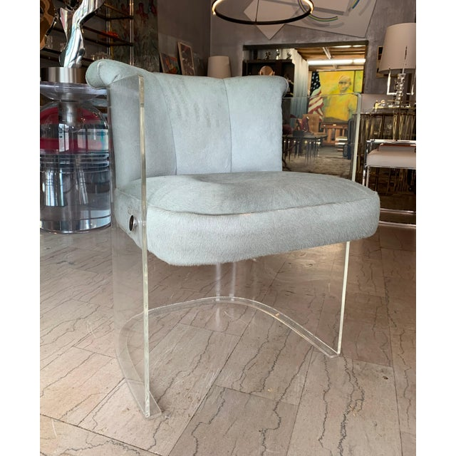 Beautiful set of 4 barrel chairs upholstered in sage green pony hair leather. The chairs are in god vintage condition, the...