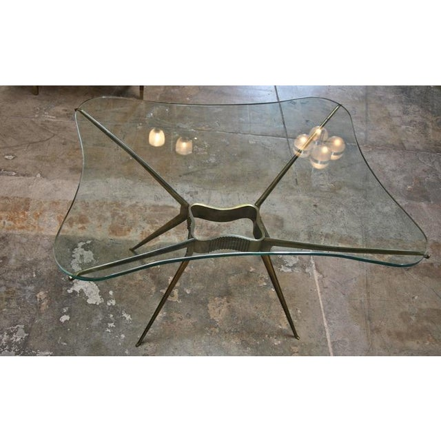 Italian 1950s brass cocktail table. This delicate design stands the test of time.