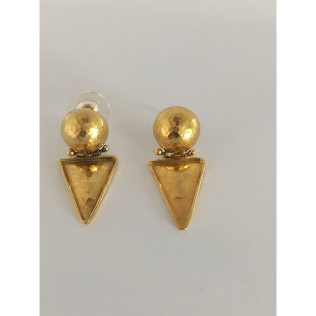 Pair of Italian 18k gold hammered earrings in the ancient style. The earrings are for pierced ears and are hinged for...