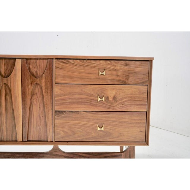 "Stunning custom hand crafted mid century ""Brasilia"" inspired design,Made of solid walnut and brass plated pulls.Sculpted..."