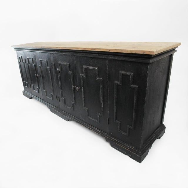 Colonial salvaged black distressed sideboard with a raw wood finished top. Large storage area with shelves below.