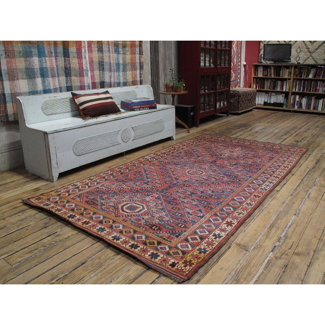 A highly collectible antique rug, attributed to the Ersari Turkmen tribes in Central Asia, in a more ornate style often...