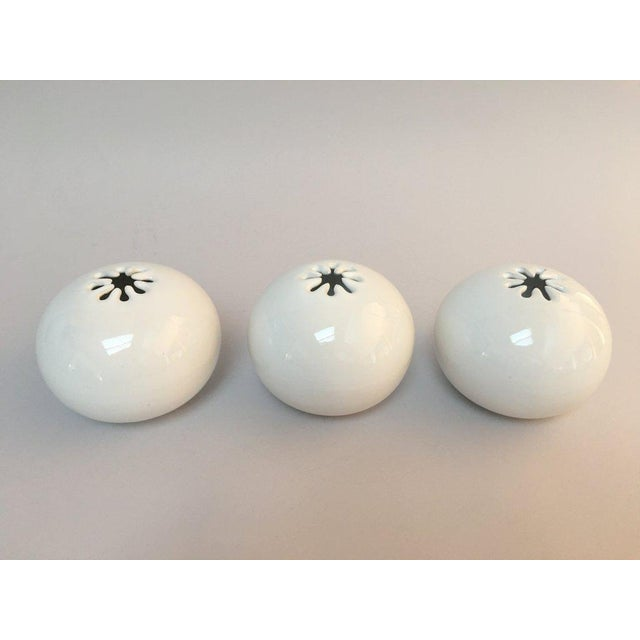 "Trio of iconic 70s era Bennington Potters orb vases with asterisk (spark) shaped opening. Each vase measures about 5"" in..."