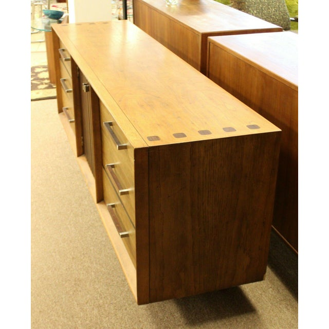 For your consideration is an incredible, ribbed pecan and rosewood bedroom set, including a nine drawer dresser, a four...
