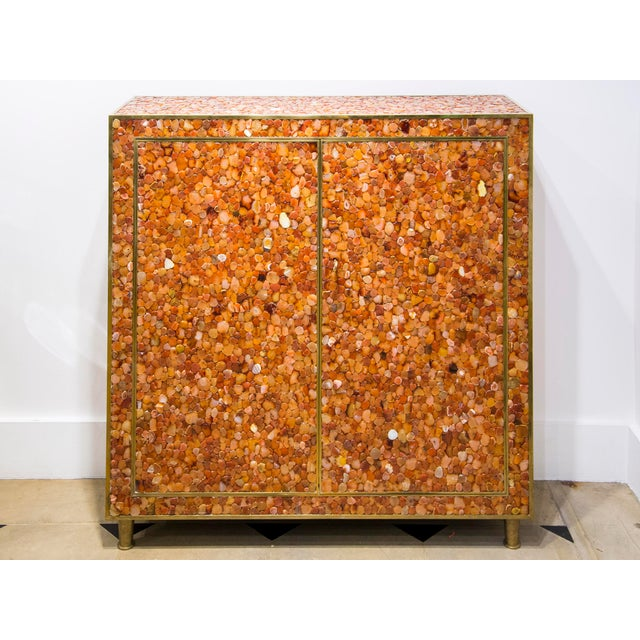 KAM TIN Agate Cabinet Cabinet covered of real agate gemstone on wood structure with brass finishes. France, 2012 The agate...
