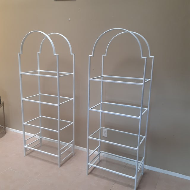 Very nice pair of Vintage painted metal white etagere's Hollywood Regency style from the 1970s.