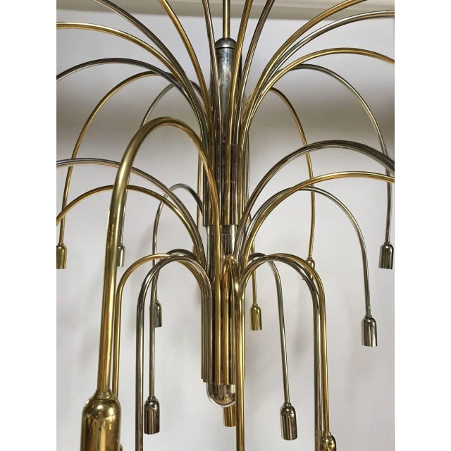 A large brass and chrome chandelier with multiple arms, German, 1970's