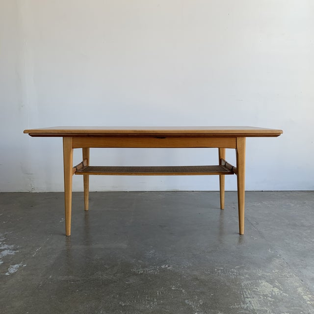 Here is an outstanding metamorphic Danish Modern teak coffee table/dining table. This unique design allows the table to...