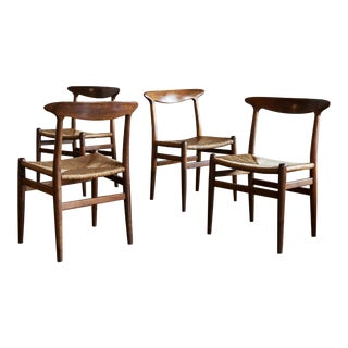 Hans Wegner Set of Four Model W2 Dining Chairs in Oak, Denmark, 1950s For Sale