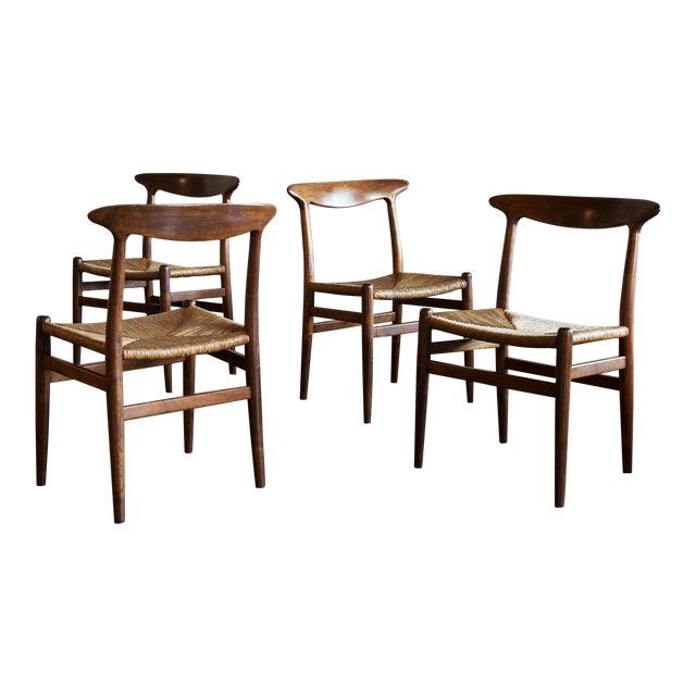 Hans Wegner Set of Four Model W2 Dining Chairs in Oak, Denmark, 1950s For Sale