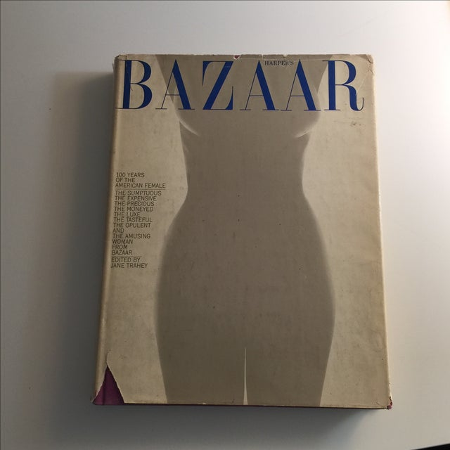 Oversized hardcover with dust jacket. 308 pages. In color and black and white. Essays and photos of fashion history. Odor...