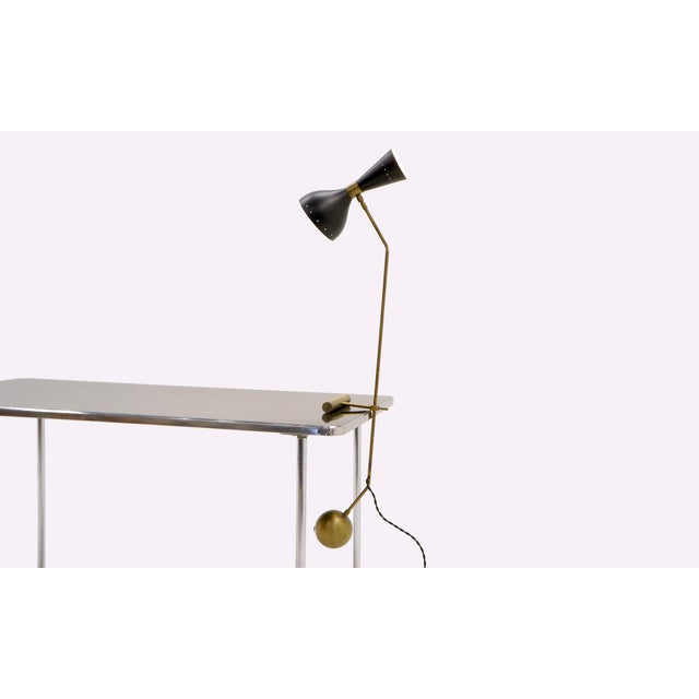 Large Italian counter-balance table or desk lamp by Stilnovo. The height is adjustable as is the lamp fixture moves 360...
