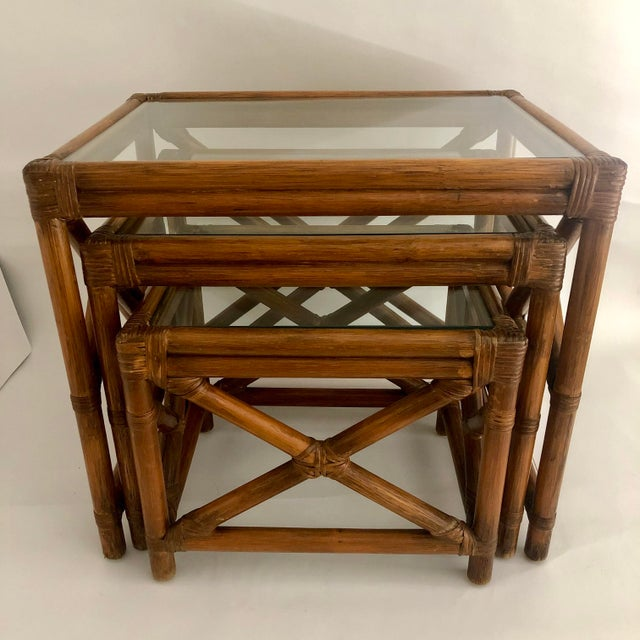 "Set of three 1960s bamboo and rattan nesting tables with inset removable glass tops. Medium, 21""W x 16""D x 18.5""H; small,..."