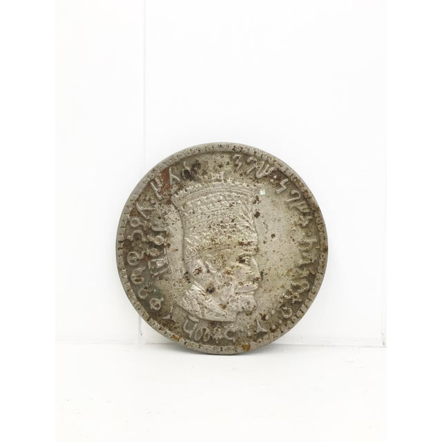 This is made in the image of what looks like an Egyptian coin. It is very heavy metal and has the beautiful patina that...