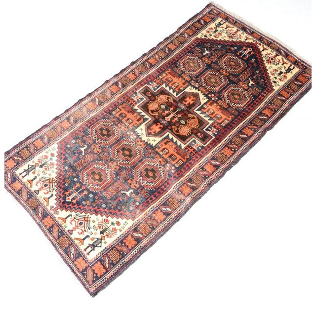 On trend colors and design! A fine hand knotted Persian Baluch pictorial rug. This rug displays a central medallion...