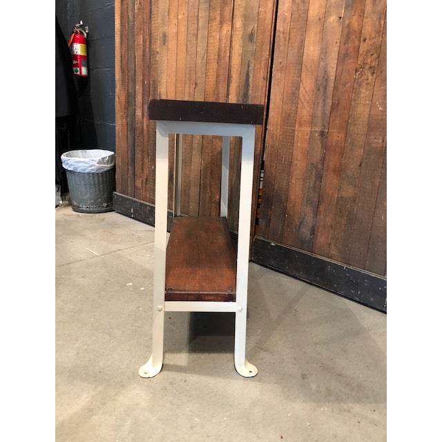 This accent table/sofa table is a special piece, mixing reclaimed wood with metal for the legs. The contrast of the dark...