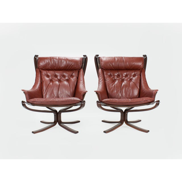 Great pair of 'Falcon' lounge chairs designed by Sigurd Resell for Vatne Møbler, Norway. The chairs have rosewood X-bases...