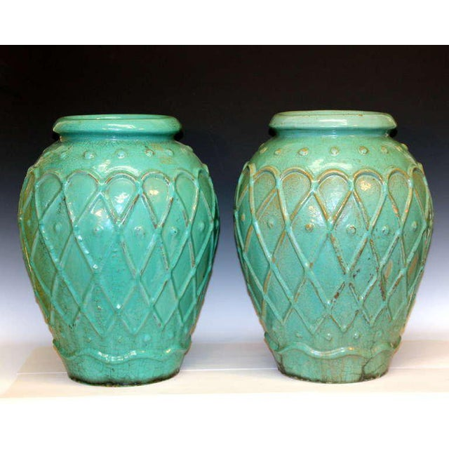 Large pair of garden urns by the Galloway Terracotta Company of Philadelphia in green/turquoise crackle glaze, circa early...