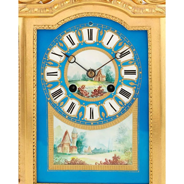 This exceptional Sèvres clock garniture is a charming work of artistry and craftsmanship. Crafted of exquisite Sèvres...