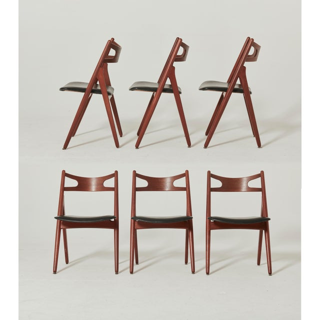 Set of six Hans Wegner CH-29 sawbuck dining chairs, designed in 1951, and made by Carl Hansen, Denmark. Teak frames and...