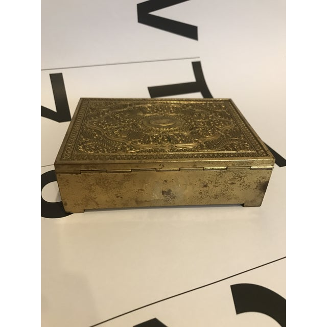 Beautiful Vintage brass clad box. Interior is lined with red velvet.